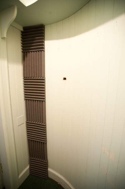 First column of acoustic tiles attached to wall