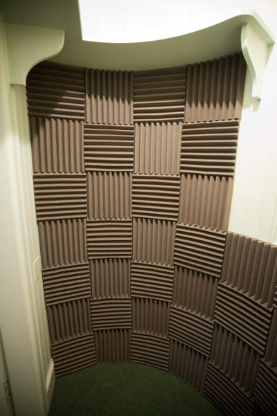 Wall covered in acoustic tiles in checkerboard pattern