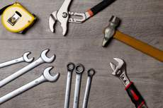 Tools including spanners, pliers, tape measure and a hammer
