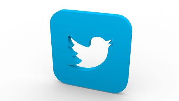 3D block with Twitter logo cut out, against a white background