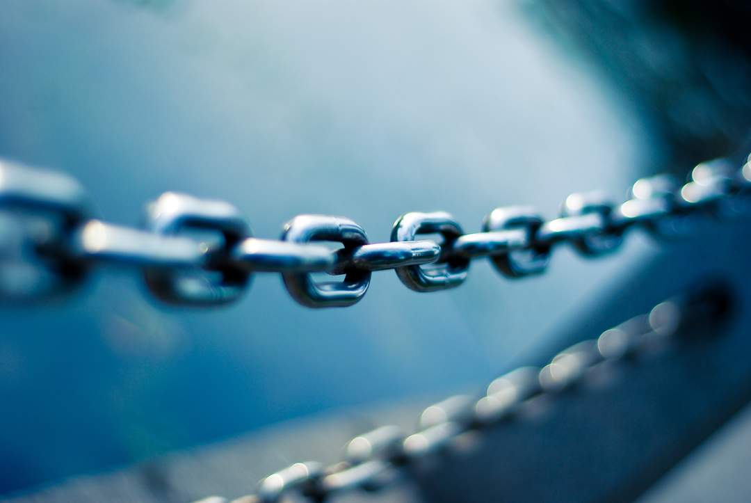 Chain links against a blue background