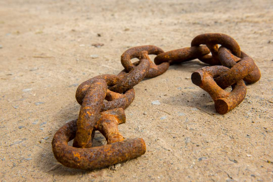 Large rusty chain with broken links at each end